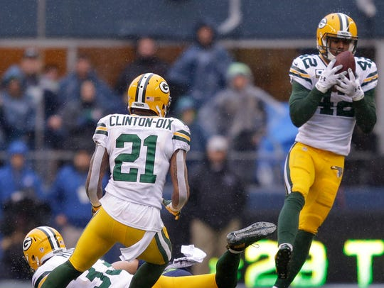 Green Bay Packers safety Morgan Burnett, right, intercepts