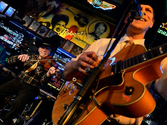 """Gene """"Pappy"""" Merritts, 86, left, and John England of the John England and The Western Swingers band perform at Robert's Western World."""