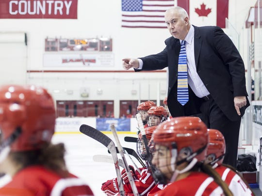 In 13 seasons coaching the Plattsburgh State women's hockey team, Kevin Houle has won 85 percent of his games and guided the Cardinals to four national championships.