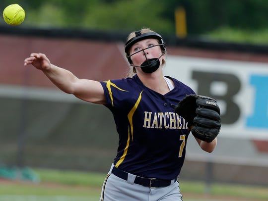 Courtney Theiler of Tomahawk makes a throw to first base for an out and the Hatchets knocked off Prescott 2-1 in eight innings to reach the Division 3 state championship game Saturday.