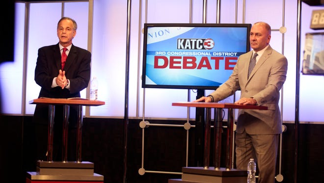 Candidates for Louisiana's 3rd Congressional District, Public Service Commissioner Scott Angelle, left, and former St. Landry lawman Clay Higgins face-off in the final debate at KATC studios in Lafayette Dec. 8, 2016.