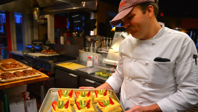 Executive Chef James Charland starts early - 5:30 a.m. , preparing and baking the popular croissants and baked goods at Ossorio Bakery & Cafe in Cocoa Village. Chef Charland with mixed fruit tarts.