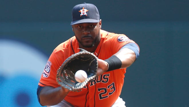 Houston Astros first baseman Chris Carter plays against the Minnesota Twins on Aug. 30, 2015, in Minneapolis.