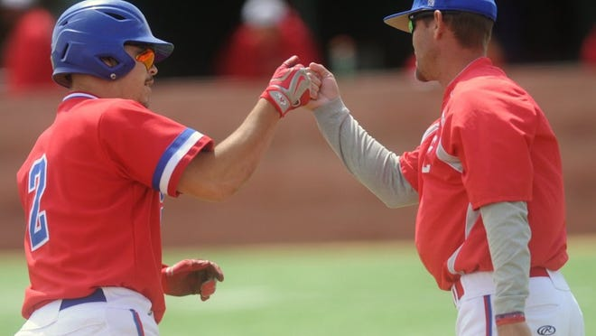 Joey D. Richards/Reporter-News Cooper coach Cody Salyers, right, congratulates Caleb Freeman as Freeman rounds third after hitting a three-run home run in the third inning. Freeman's blast gave the Cougars a 3-2 lead over El Paso Jefferson. The senior drove in five runs in the Coogs' 6-4 victory over the Silver Foxes on Saturday to sweep the best-of-three Region I-5A area playoff series in Odessa.