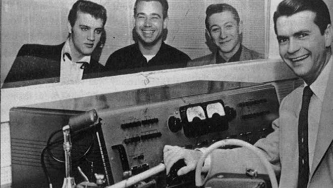 In this photo released by Sun Records, Elvis Presley, left, bass player Bill Black, guitarist Scotty Moore and Sun Records and Memphis Recording studio head Sam Phillips take a break from a recording session in Memphis in 1954. Presley cut his first records in the studio owned by Phillips.