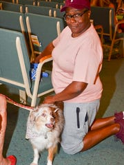 Suzanne Dailey gives some love to Remi, a pet therapy