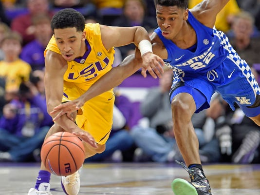 Kentucky guard Shai Gilgeous-Alexander (22) and LSU guard Tremont Waters (3) battle for control of a loose ball in the second half of an NCAA college basketball game, Wednesday, Jan. 3, 2018, in Baton Rouge, La. Kentucky won 74-71. (AP Photo/Bill Feig)