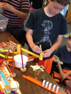 Collect any items around the house and use them to make a Rube Goldberg contraption.