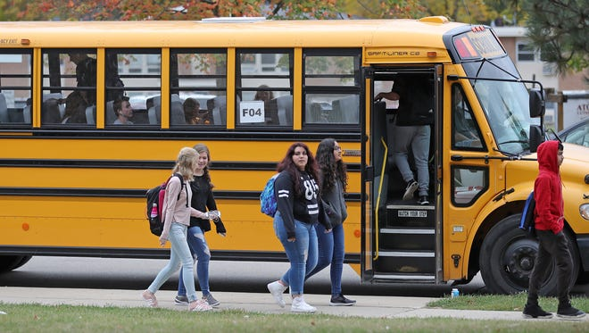"""Students board buses to depart Green Bay Preble High School. The Green Bay School District received its state-issued report card and was rated """"meets few expectations,"""" though it's overall score did increase slightly."""