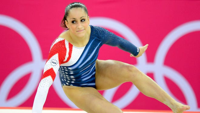 Aug 7, 2012; Jordyn Wieber rolls on the ground after competing in the women's floor exercise final during the 2012 London Olympic Games at North Greenwich Arena.