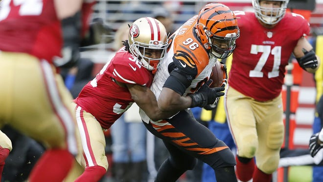 Cincinnati Bengals defensive end Carlos Dunlap (96) returns a fumble recovery in the second quarter during the Week 15 NFL game between the Cincinnati Bengals and the San Francisco 49ers, Sunday, Dec. 20, 2015, at Levi's Stadium in Santa Clara, California. The Bengals lead 21-0 at halftime.
