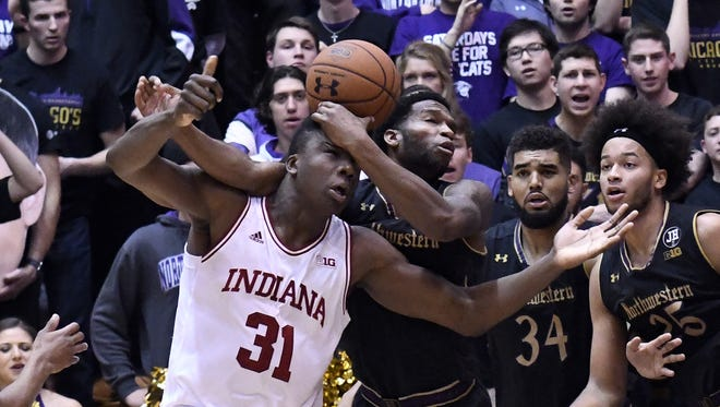 Hoosiers center Thomas Bryant (31) and Northwestern Wildcats forward Vic Law (4) go for the ball during the second half at Welsh-Ryan Arena.  The Wildcats won 68-55.