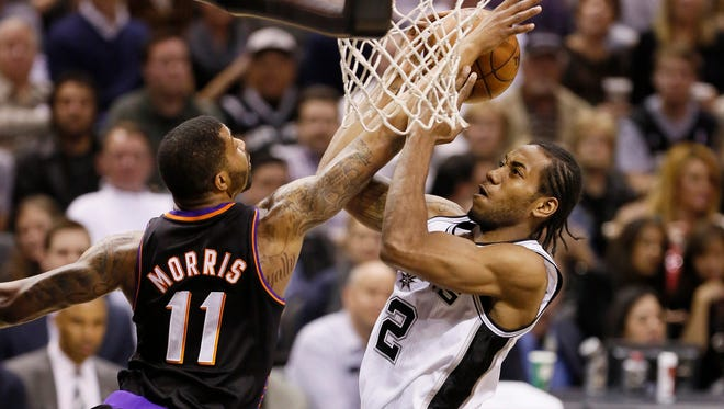 The Suns' Markieff Morris and the Spurs' Kawhi Leonard, shown in a 2013 game, have each proved they were smart first-round picks in the 2011 draft.