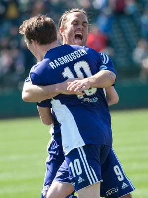 Louisville City FC midfielder Magnus Rasmussen gets a hug from forward Matt Fondy after Rasmussen scores the first goal in the club's season opener at Slugger Field..