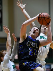 Castle's Jace Stieler (24) shoots under defensive pressure from North's Zach Mosteller (3) (left) and Ryan Huebner (5)as the Castle Knights play the North High Huskies for the Class 4A Sectional Championship at North Saturday, March 3, 2018.