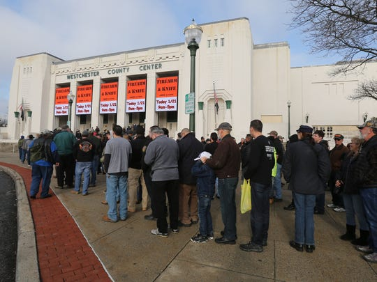 Long lines of people queue up to get inside the Firearm and Knife show at the Westchester County Center, Jan. 21, 2017.
