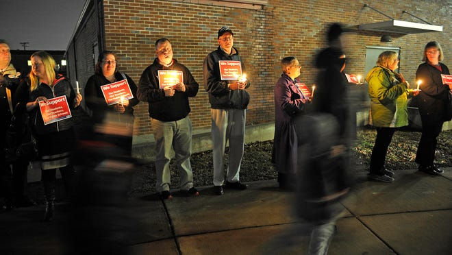 Outside meetings at Neely's Bend and Madison middle schools, members of the state and local teachers unions — as well as out-of-state teachers in town for an unrelated event — held candles and signs to demonstrate their opposition to a charter school takeover.