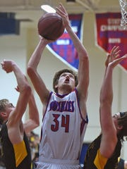 Reno's Tommy Challis shoots between Galena's Moses
