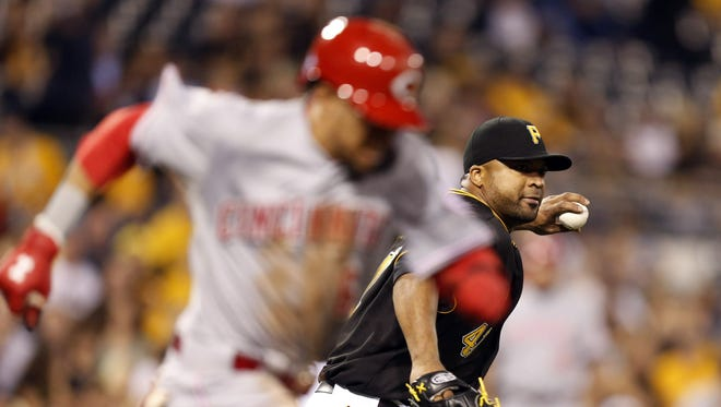 Pittsburgh Pirates starting pitcher Francisco Liriano (right) throws out Cincinnati Reds center fielder Billy Hamilton (6) who attempted to bunt for a base hit during the fifth inning.