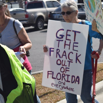 Anti-fracking activists rally in Cascades Park earlier