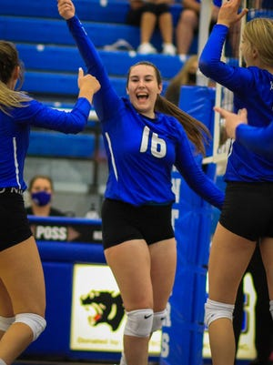 Senior Lady Panther Valerie Young celebrates a point with her teammates.