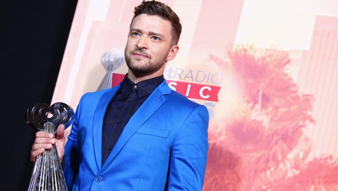 Justin Timberlake poses in the press room with the iHeartRadio Innovator award at the iHeartRadio Music Awards at The Shrine Auditorium on Sunday, March 29, 2015, in Los Angeles.