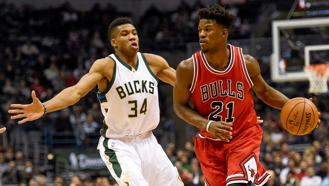 Bulls forward Jimmy Butler drives for the basket against Bucks forward Giannis Antetokounmpo.