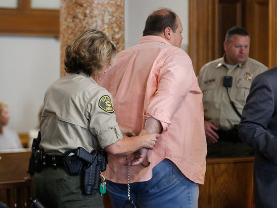 Eddie Tipton is put in handcuffs on Aug. 22, 2017, at the Polk County Courthouse in Des Moines after being sentenced to 25 years in prison for his role in the nation's largest lottery scam.