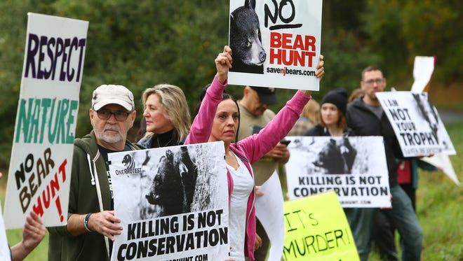 The annual six-day, state-sanctioned  bear hunt, designed to help control the growing bear population in northwestern New Jersey. More than 50 protesters gathered at a grassy area off Fredon Springdale Road. October 14, 2017. Fredon, New Jersey