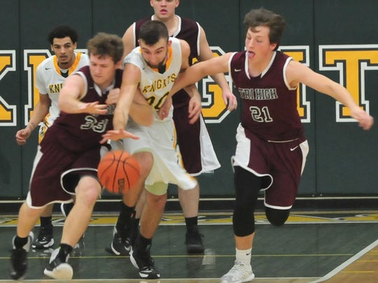Northeastern's Nate Reynolds (30) forces a turnover