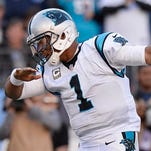 Carolina Panthers quarterback Cam Newton celebrates after scoring a touchdown on a 2-yard run against the Tennessee Titans in the second half of an NFL football game Sunday, Nov. 15, 2015, in Nashville, Tenn. The Panthers won 27-10.
