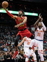 Atlanta Hawks forward DeAndre' Bembry goes to the basket