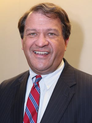 State Sen. George Latimer, D-Rye, poses for a photograph Oct. 23, 2012 before a debate in Rye Brook. A mortgage servicer filed foreclosure papers on Latimer's Rye home Dec. 12 because Latimer allegedly hasn't paid his mortgage since January. ( Joe Larese/The Journal News )