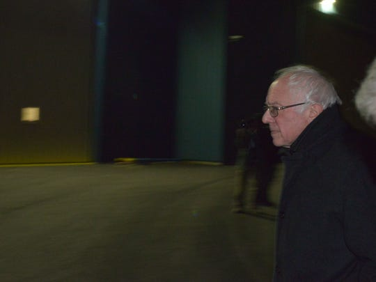 Bernie Sanders makes his way across the tarmac after landing in Manchester, New Hampshire, in the pre-dawn hours of Feb. 2, 2016.