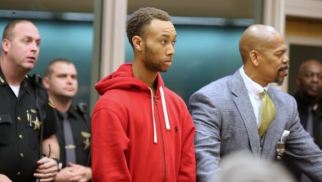 Rico Mosley, 19, was arraigned April 1 in the shooting death of Kelsie Crow, 17. Bond was set at $800,000. Clyde Bennett II, at right, is his attorney.
