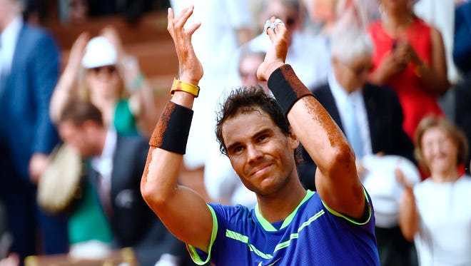 Spain's Rafael Nadal celebrates after winning the men's final tennis match against Switzerland's Stanislas Wawrinka at the Roland Garros 2017 French Open on June 11.