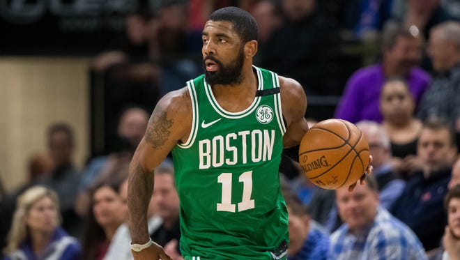 Boston Celtics guard Kyrie Irving (11) dribbles in the third quarter against Minnesota Timberwolves at Target Center.