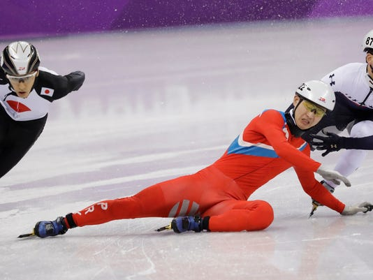 Jong Kwang Bom of North Korea crashes during their men's 500 meters short track speedskating heat in the Gangneung Ice Arena at the 2018 Winter Olympics in Gangneung, South Korea, Tuesday, Feb. 20, 2018. (AP Photo/Bernat Armangue)