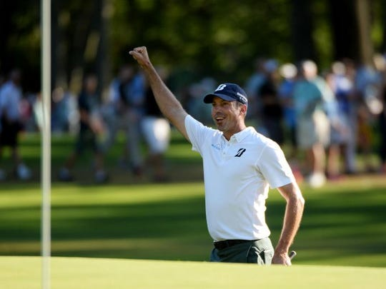 Matt Kuchar celebrates after chipping for birdie on the 18th hole during the final round of The Barclays at The Ridgewood Country Club on August 24, 2014 in Paramus, New Jersey.