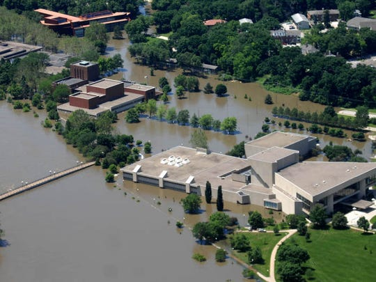 Floodwaters surround the University of Iowa's Hancher Auditorium and the art campus buildings on Monday, June 16, 2008.