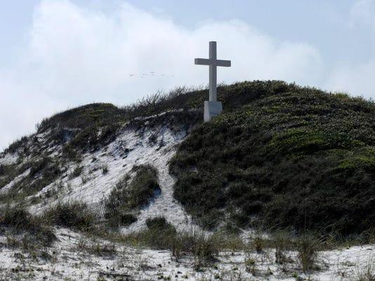 cross marks first mass