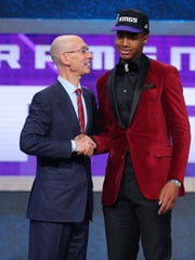 Marquese Chriss greets NBA commissioner Adam Silver