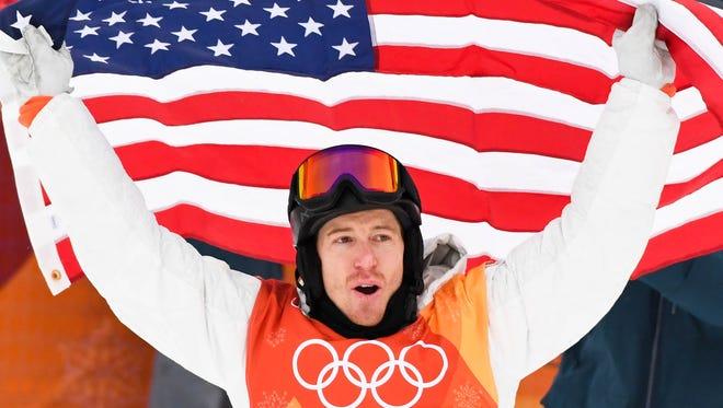 Feb 14, 2018; Pyeongchang, South Korea; Shaun White (USA) celebrates winning gold in the mens snowboarding halfpipe final during the Pyeongchang 2018 Olympic Winter Games at Phoenix Snow Park. Mandatory Credit: Kyle Terada-USA TODAY Sports