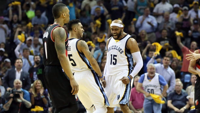 Grizzlies guards Courtney Lee, left, and Vince Carter  celebrate after a play.