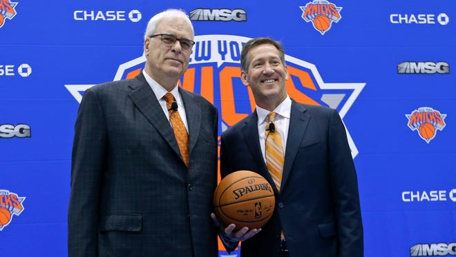 New York Knicks president Phil Jackson, left, and head coach Jeff Hornacek, pose for photographs during a news conference to announce the hiring of Hornacek as the head coach.