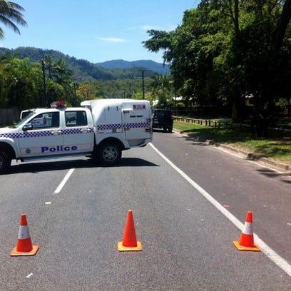 A police car blocks a street at an address in Manoora