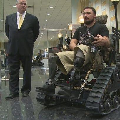 U.S. Marine veteran Michael Fox tries out his new all-terrain