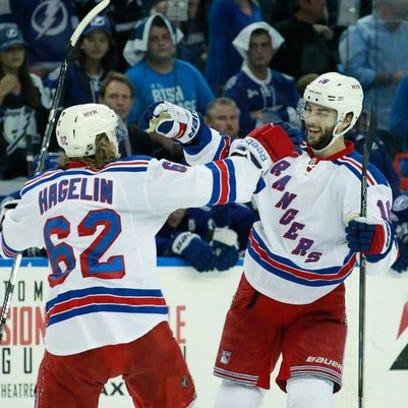 New York Rangers center Derick Brassard (16) celebrates
