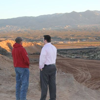Mesquite liaison officer Aaron Baker, right, and field
