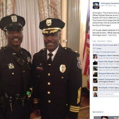 Officer Michael Spencer (left) is shown here in April